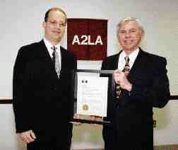 Hill Cox, (right) of the Canadian Central Gauge Laboratory receives the first non-U.S. ISO Guide 25 accreditation from American Association for Laboratory Accreditation president Pete Unger.