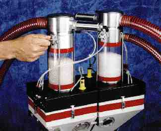Shown mounted on a Maguire Micro-Blender unit are two mini-receivers for Maguire's Clear-Vu system.