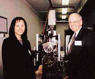 U of T Professor Steve Balke and graduate student Lianne Ing at the nozzle of Macro Engineering's glass extruder