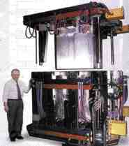 FGL's Frank Meisels stands beside 90,000 lb. mold that produced the award-winning, large crate.