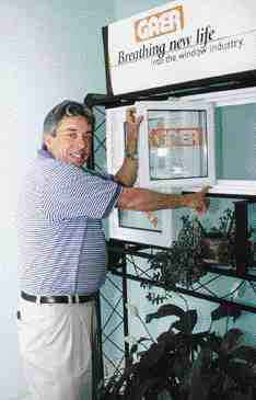 The products that started it all: Gaer president Rick O'Donnell shows some of his company's innovative window hardware.