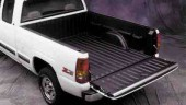 General Motors will offer a pickup truck box made of composite materials on the full size Chevy Silverado beginning in the fall of 2000. The box's fenders and outer tailgate panel are made of reinforced reaction injection molded materials (RRIM), mainly polyurea and mica filler. The one piece inner panel and the inside of the tailgate are formed by structural reaction injection molding (SRIM) of a 50/50 mix of urethane and glass-fibre. The use of these materials reduces the truck weight by about 50 lb. They will be produced at the GM truck assembly plant in Fort Wayne, IN.