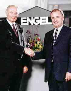 Karl Pieper (lt) recently stepped down as president of Engel North America. Franz Reiterer (rt) will take over as president