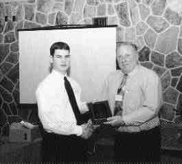 1999 Best Moldmaking TechnicianCAMM president Burt Kenney presents a plaque to award-winnner Jeffery Moore.1999 Best Plastic Mold Design TechnicianMike Hicks, sales manager, Diemould Service Co. (Canada) Ltd., presents a trophy to award-winner Sam Shiu.