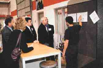 Magna Training Centre apprentice John Perrota points to a list of required tooling projects on a tour organized by the CPIA Mould Makers Council. Magna uses Cimatron's CAD/CAM tooling software package to train students in surfacing and generating NC tool paths.