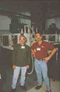 Nypro group leader Jay Needham (right) and maintenance supervisor Les Cieszkowski successfully oversaw the conversion of a high-volume polycarbonate gear to vented molding, eliminating drying.