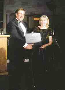 CPIA president and CEO Pierre Dubois presents a Canplast Award to Janet Jarvela for her valuable contributions to CPIA's Vinyl Council of Canada over the past five years. Jarvela is public policy communications manager with Dow Chemical Canada Inc.In 1998 Jarvela played a key role with the VCC during negotiations with Health Canada on the phthalate and toy issue.
