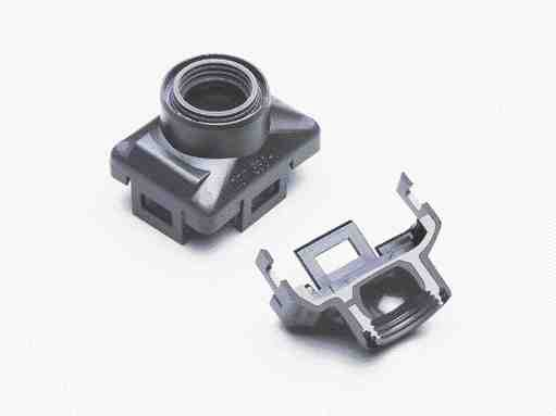 These sensor housings for automobile headlamp adjustment are watertight because of the good seal between Hostaform acetal and Thermolast-K TPE.