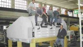 World's largest granulator? Employees of Hosokawa Alpine are shown on top of the granulator's cutting chamber, which measures 36 in. by 114 in. The machine was recently installed, piece by piece, at a major BOPP film extruder's facility.