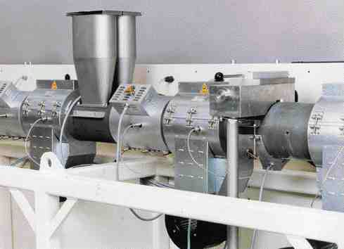 Two stage venting and a longer processing unit (36:1 L/D) provide improved heat transfer in the melt, says Krauss-Maffei of its new extruders for PVC pipe production.