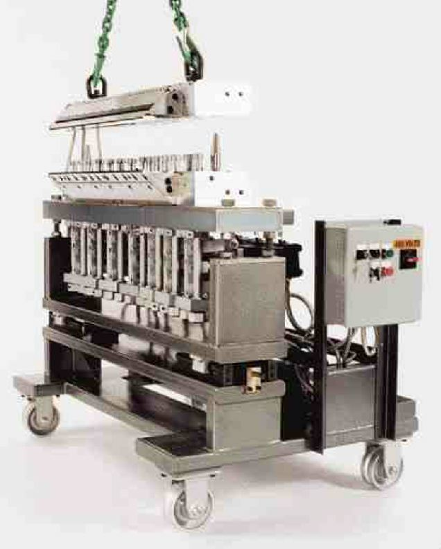 EDI's boltless die system uses a mechanized process that clamps and releases die halves in less than one minute.