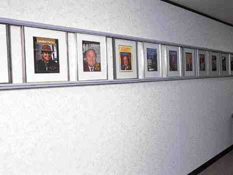 The past and present meld together: The walls of the CPIA's boardroom are adorned with pictures of CPIA Industry Leaders on the covers of Canadian Plastics magazine.