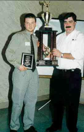 2001 Best Moldmaking TechnicianAndrew David Maynard (lt.) receives a trophy from Brian Campbell of D-M-E Canada. Andrew also received a gift certificate from M2M International and a plaque from CAMM.