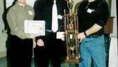 2001 Best Manufacturing Technician CAD/CAM DesignDerrick Michael (centre) receives a trophy and gift certificate from Ed Bernard (rt.) of Bernard Mould and a gift certificate for a student version of CadKey from Wayne Rose (lt.) of Cornerstone Technologies.