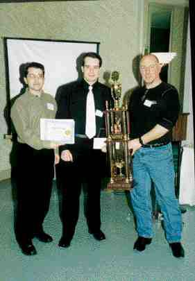 2001 Best Manufacturing Technician CAD/CAM DesignDerrick Michael (centre) receives a trophy and gift certificate from Ed Bernard (rt.) of Bernard Mould and a gift certificate for a student version of CadKey from Wayne Rose (lt.) of Cornerstone Technologies.