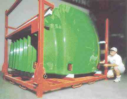 Full circle: Combines used to harvest crops such as soy and corn are now being made with polyurethane RIM panels containing soy-based polyols. These panels for John Deere combines are molded by G.I. Plastek.