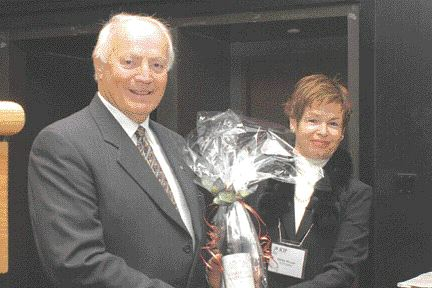 Quebec entrepreneur and keynote speaker Herv Pomerleau receives a gift from Odette Mercier, executive director of CPIA Quebec, at the group's annual meeting.