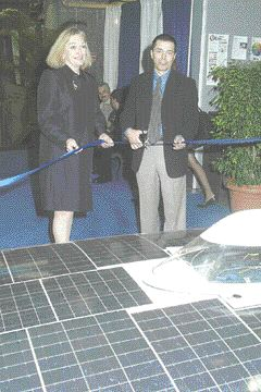 A solar powered car (foreground) developed by engineering students at Montreal's McGill University was featured at the Expoplast ribbon-cutting ceremony and remained on display throughout the day. Sally Damstra, show director, and Robert Gauthier, president, CPIA Quebec, opened the show.