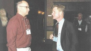 Speaker Alex Lidback (rt.) chats with Noel Legault of CPI Plastics Group Ltd. during a refreshment break.