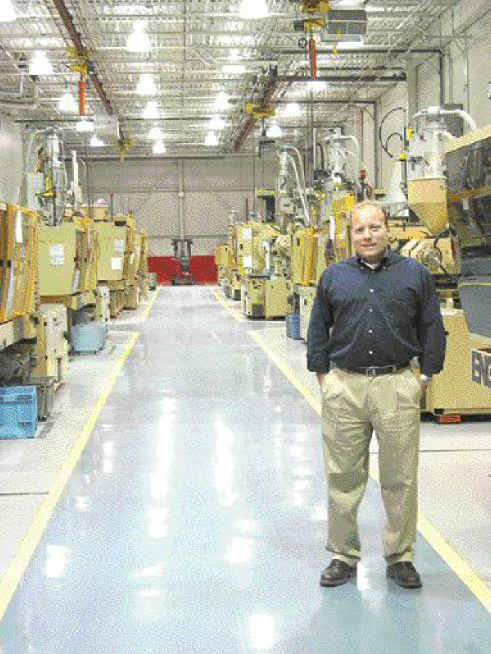Although Huronia Precision Plastics is running at full production, president Ralph Befort is the sole employee in sight. All 35 machines at the plant are set-up for automated, unattended operation.