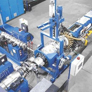 Krauss-Maffei's QuickSwitch dimensional change system was retrofitted to an extrusion line in Germany. Key components of the system are the pipehead, suction bell and calibrating basket.