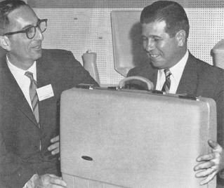 Sam Kauffman (lt.), president of Kayson Plastics, shows a polypropylene suitcase to William Carter, writer for Canadian Plastics.