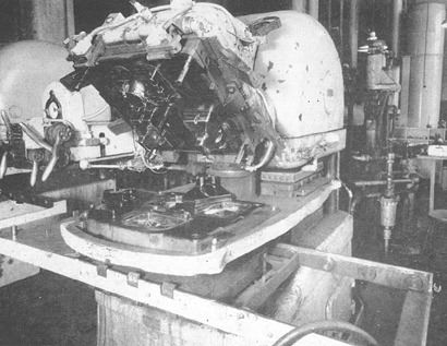 Before injection molding machines, parts were often made on compression machines, such as this 350 ton Duo press used by Northern Electric to mold phone parts.