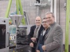 Admiring the new machine are (left to right) David Alcock and Hamid Mohammadi of CPTC, and Glen Billinger of Plastics Machinery Inc., which represents Sumitomo.