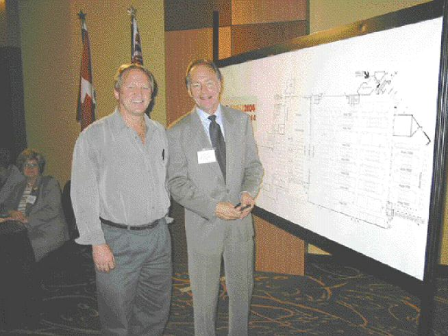 Richard Wozniak of Husky Injection Molding Systems Ltd. (left) had first choice of exhibit space at the Plast-Ex 2004 space draw. Shown with him is Tom Sockett of the Canadian Plastics Industry Association (CPIA), which owns Plast-Ex.