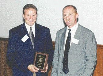 CAMM and CTMA hold first joint meeting -- Canadian Association of Moldmakers' president Ted Callighen (rt.) presented Tom Hazen, accounts manager, Brush Wellman, with a speaker's award at the joint CAMM/CTMA held this September in Windsor, ON. The meeting was the first formal joint meeting of the two groups since the formation of the Canadian Machine, Tool, Die and Mould (MTDM) Federation earlier in the year.