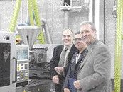 Present at the installation of CPTC's new all-electric injection molding machine are (from left) David Alcock and Hamid Mohammadi of CPTC and Glen Billinger of Plastics Machinery Inc., which represents Sumitomo in Eastern Canada.