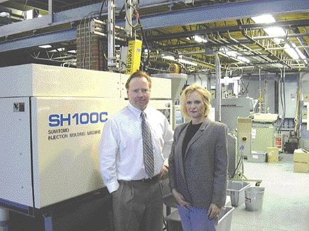 Siblings Bill Book and Cathy Cremers, in front of G.S. Book Plastics' first all-electric injection molding machine. Bill Book says his father Barry inspired a culture of innovation at the company.
