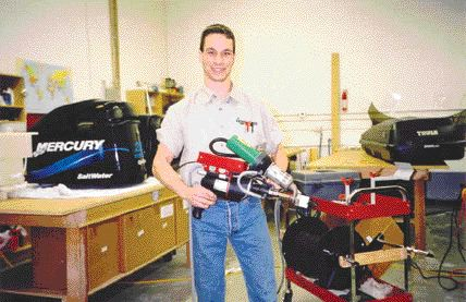 Brad Morrison, owner of Profab Plastics, holding a brushless-drive, portable hand extrusion welder he uses to fabricate and assemble products. He frequently uses less sophisticated hand welding equipment and techniques to repair plastics.