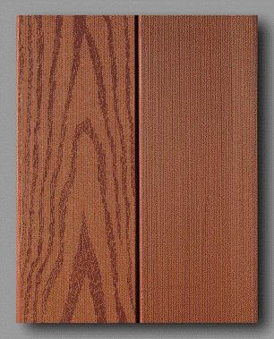 Composatron's deck boards show wood grain on one side, or a smoother planed finish on the other side. The consumer can choose which will face up.