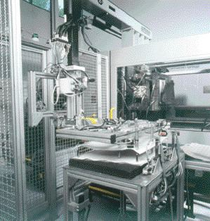 Wittmann Inc. and partners have developed a robotic system capable of handling textile materials. The top-entry servo robot's EOAT is equipped with needle grippers for grabbing and lifting textile, then inserting the material into a mold. The same robot then removes the molded part from the other half of the mold.