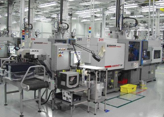By using under-press conveyors and automated guided vehicles, operators are freed from parts handling duties.