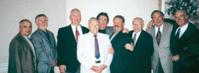 Pete Hedgewick with a group of former ITL employees who helped organize the reunion: (from lt. to rt.) Ron Burnett, Bill Imire, Lloyd Kirby, Pete Hedgewick, Jim Lebeauf, Mike Monger, Don Garant, Joe Hoesvar and Armando Cerrini. According to Ron Burnett, one of the organizers of the event, as many as 90 moldmaking shops have been founded by former employees of ITL.