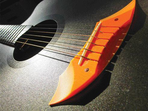 While their guitars gently extrude: Cool Acoustics' FFS2002 all-polymer acoustic guitar