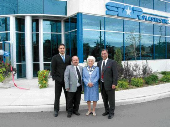 (Left to right) Carlo Nudi, operations manager Tony Suriano, Mississauga mayor Hazel McCallion and company owner Jas Dhami in front of Star Plastics' new facility.