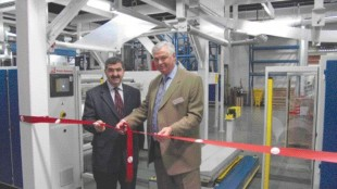 Rami Younes, left, chair of the board of Brampton Engineering directors, and president and CEO R.L. Bud Smith at the opening of BE's new Film Technology Centre.
