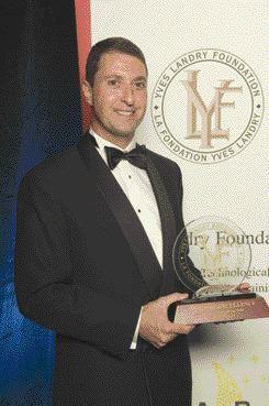 Jonathon Fischer, president of Mold-Masters, accepts the Yves Landry award.
