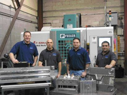 Denis Comartin, Jeff Pillon, Anthony Piazza and Gaetano Scalia on the shop floor of Absolute Tool Technologies' 6,500 square foot facility, which opened in Windsor, Ont. in January 2006.