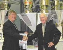 Wittmann Canada's Rob Miller (left) and Mould-tek's Lorne Berggren, with the M-Tek blender line acquired by Wittmann.