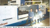 Michael Draga, Royal Mould Technologies Ltd. president Angel Niera, and production manager Nicholas Roddy with the company's new Takumi V-32 35 HP high-speed heavy cutting machining center.