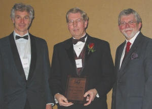 Paul Clark (centre) receiving the Purvis Memorial Award from SCI Canadian chairman David Beckman (left) and Serge Lavoie (right).