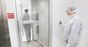 """Secured controlled access to a Class 10,000 cleanroom through a """"blow down"""" chamber and gowning area."""