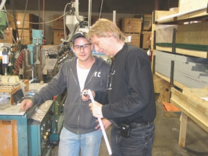 Tom Boer (right) checks product quality at Elton Manufacturing.
