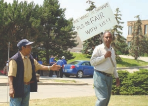 Workers laid off from Progressive Moulded Products protesting in July.