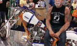 "Familiar faces at the show included Paul Teutul, Sr. star of the hit TV show ""American Chopper"". Teutul is posing with a chopper that was custom-built by his company, Orange Country Choppers, for NPE exhibitor Aaron Equipment Company, made from pieces of Aaron Equipment's used and reconditioned processing equipment."