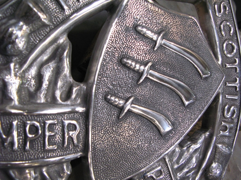 Close-up of the machined and polished Scottish Essex Regimental crest.